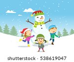 happy kids playing with snowman | Shutterstock .eps vector #538619047