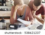 young couple calculating their... | Shutterstock . vector #538621237