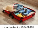 open travel bag with clothes ... | Shutterstock . vector #538628437