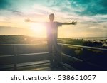 Stock photo silhouette man happy with hands rise up on beautiful christian praise on hill thanksgiving day 538651057