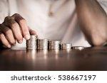 close up hand putting money... | Shutterstock . vector #538667197