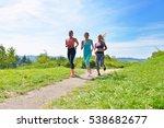 three female joggers running... | Shutterstock . vector #538682677