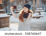 girl walking on snow covered... | Shutterstock . vector #538760647