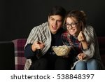 young couple watching a movie... | Shutterstock . vector #538848397