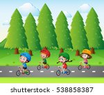 park scene with kids riding... | Shutterstock .eps vector #538858387