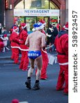Small photo of LIVERPOOL UK, 4TH DECEMBER 2016. Speedo Mick a charity fundraiser taking part in the annual 5k Santa Dash for charity on the streets of Liverpool