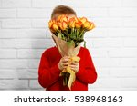 Cute Boy With Bouquet Of...
