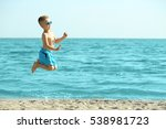Cute Boy Having Fun On Beach