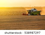 Combine Harvester In Action On...