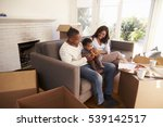 Family Take A Break On Sofa...
