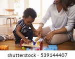 mother and son playing with... | Shutterstock . vector #539144407