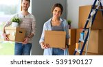 happy young couple unpacking or ... | Shutterstock . vector #539190127