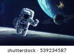 astronaut at spacewalk. cosmic... | Shutterstock . vector #539234587