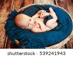 the small baby lies in blue... | Shutterstock . vector #539241943