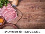 raw pork schnitzel with the... | Shutterstock . vector #539262313