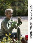 pensioner is working in the... | Shutterstock . vector #539617627
