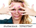 Small photo of Portrait of funny middle aged blonde woman. Adult female wearing blue blouse showing pink nails in front of face.