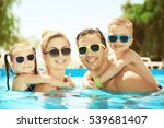 happy family in swimming pool... | Shutterstock . vector #539681407