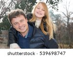 Small photo of Father and girl accomplice and happy in this autumn day or winters in a park