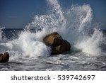Splits Waves Against Rocks In...