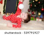 little boy in new year's pajama ... | Shutterstock . vector #539791927