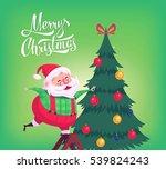santa claus decorating tree... | Shutterstock . vector #539824243
