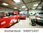 crashed cars in a car repair... | Shutterstock . vector #540071437