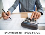 male hands working with papers | Shutterstock . vector #540154723