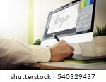 designer designing a logo. all... | Shutterstock . vector #540329437