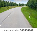 empty curved road with trees | Shutterstock . vector #540338947