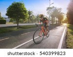 Man Riding Bicycle On The Tile...