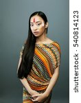 Small photo of beauty young asian girl with make up like Pocahontas, red indian