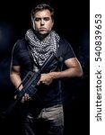 Small photo of Soldier or mercenary wearing a shemagh with assault rifle, paintball or airsoft gun