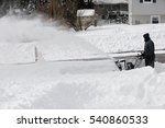 Man Removing Snow On The...