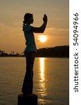 Girl Doing Yoga On A Sunset
