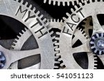 Small photo of Macro photo of tooth wheel mechanism with imprinted MYTH, FACT concept words