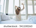 woman stretching in bed after... | Shutterstock . vector #541100263