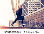 business woman carrying a... | Shutterstock . vector #541173763