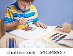 child painting with aquarelles. | Shutterstock . vector #541348927