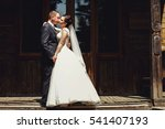 bride leans to a groom for kiss ... | Shutterstock . vector #541407193