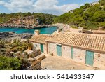 Small photo of Traditional stone houses in Cala S'Almonia, Mallorca island, Spain