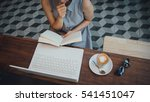 hipster woman reading book and  ... | Shutterstock . vector #541451047