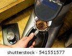 barista grinds coffee beans in... | Shutterstock . vector #541551577