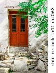 Small photo of Door and stairs in the village Manolates on the aegean island Samos