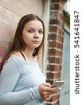 teenage girl texting on mobile