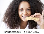 smiling african woman eating a... | Shutterstock . vector #541642267