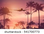 airplane flying over tropical... | Shutterstock . vector #541700773