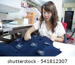 female worker at garment factory | Shutterstock . vector #541812307