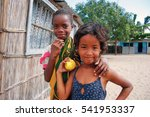 Small photo of INHACA, MOZAMBIQUE - 8 APRIL 2012: Two girls outside a shack on Inhaca Island. Inhaca is a 52 km² subtropical island that separates Maputo Bay from the Indian Ocean & is a popular resort. Editorial.