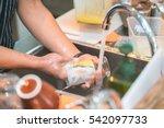 human hand washing dish or... | Shutterstock . vector #542097733